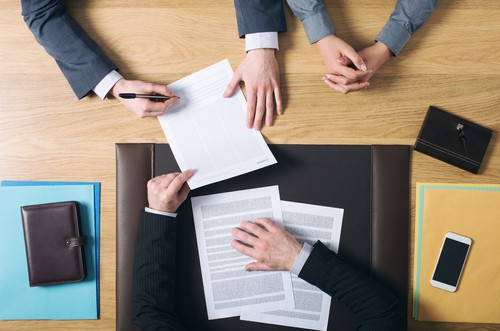 lawyer providing papers at business sale